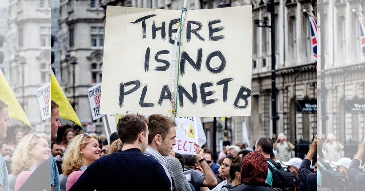 Protester holding banner reading 'There is no planet B'